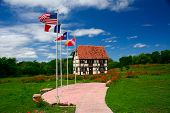 stock photo of alsatian  - Alsatian house and park serves as the visitor center for the Little Alsace of Texas - JPG