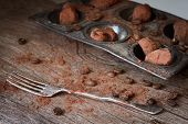 pic of truffle  - Chocolate truffles in an unusual shape with metal cutlery - JPG