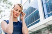 pic of concentration  - Businesswoman standing in street and trying to concentrate - JPG