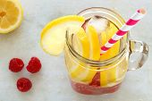 picture of masonic  - Spa water with lemon and raspberries in a mason jar with straw - JPG