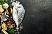 foto of fish  - Delicious fresh fish on dark vintage background - JPG