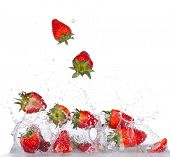 pic of backround  - Fresh strawberries in water splash isolated on white backround - JPG