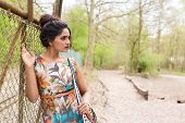 stock photo of indian beautiful people  - a beautiful young Indian woman posing outdoors - JPG