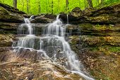 stock photo of cataract  - This small waterfall flows over rocky ledges in Owen County Indiana - JPG