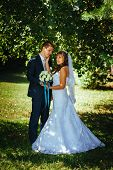 stock photo of bridal veil  - Bride and Groom at wedding Day walking Outdoors on spring nature - JPG