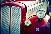 pic of headlight  - Old car front view with headlights and grill - JPG