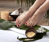 pic of wet feet  - Female feet with drops of water on spa background - JPG