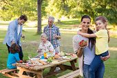 picture of extended family  - Extended family having an outdoor lunch on a sunny day - JPG