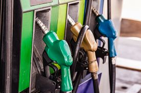 picture of petrol  - colored petrol gas pump nozzles in a service station - JPG