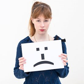 picture of emoticon  - portrait young woman with board sad emoticon face sign  - JPG