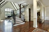 foto of entryway  - Foyer in luxury home with arched entry into dining room - JPG