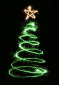 stock photo of xmas tree  - green sparkler christmas tree spiral with star - JPG