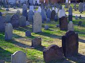 stock photo of 1700s  - Old cemetery with stone headstones from the 1700s taken in Salem - JPG