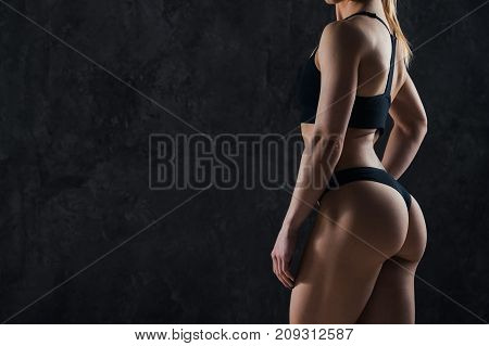 poster of Healthy lifestyle diet and fitness. Beautiful slim woman's body. Perfect slim toned young body of the girl. Fitness or plastic surgery and aesthetic cosmetology. Taut elastic ass. Firm buttocks.