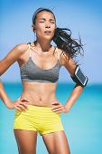 Sport fitness runner woman tired breathing during difficult workout. Heat exhaustion dehydrated jogg poster