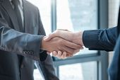 Businessmans Handshake. poster