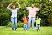 Happy Family Portrait Outdoors poster