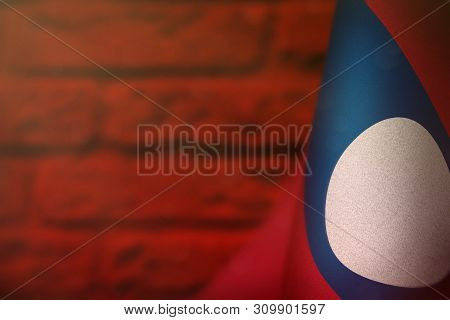 poster of Lao People Democratic Republic Hanging Flag For Honour Of Veterans Day Or Memorial Day On Red Blurre