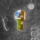 picture of open door  - Open door to freedom behind old scratched lock keyhole - JPG