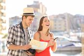 Happy Couple Of Tourists Enjoying Vacation Travel  Holding Smart Phone And Touristic Guide poster