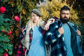 Hipster Style. Man Bearded Hipster And Girl Wear Kepi Hat. Checkered Style. Couple Handsome Bearded  poster