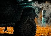 Expedition Offroader. Bottom View To Big Offroad Car Wheel On Country Road And Mountains Backdrop. O poster