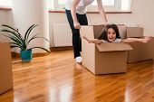 Happy Kid Daughter In Box Excited About Moving Day Or Relocation, Cheerful Girl Playing Unpacking In poster
