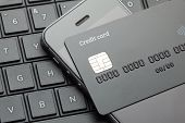 Black Style. Credit Card And Mobile Phone Smartphone On The Keyboard With Laptop. Online Payment For poster