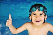 stock photo of swimming  - Little boy at swimming pool - JPG