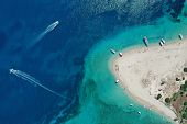 Aerial Drone View Of Iconic Small Uninhabited Island Of Marathonisi Featuring Clear Water, Sandy Sho poster