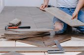 Man Laying Parquet Flooring - Closeup On Male Hands. Worker Joining Parquet Floor poster