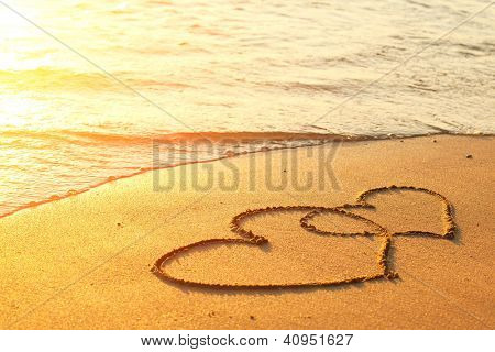 Picture or Photo of Hearts drawn on the sand of a beach