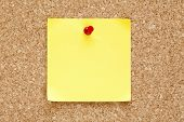 pic of memory stick  - Blank yellow sticky note pined on a cork bulletin board - JPG