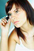 Brunette Girl Doing Makeup poster