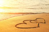 stock photo of rest-in-peace  - Hearts drawn on the sand of a beach - JPG