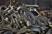 foto of ferrous metal  - Stack of cast metal parts in a iron foundry