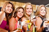 foto of party people  - group of happy girls smiling in a bar or a nightclub - JPG