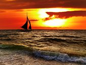 Tropical sunset with sailboat, Boracay, Philippines