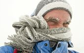 stock photo of storms  - young man in winter storm with frozen eyebrows - JPG