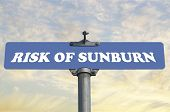 stock photo of sunburn  - Risk of sunburn road sign - JPG