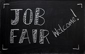 stock photo of unemployed people  - Job Fair welcome sign written on a used blackboard - JPG