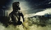 stock photo of nuclear disaster  - Stalker against nuclear background - JPG