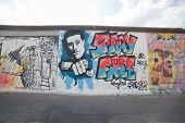BERLIN, July 26: Graffiti at the East Side Gallery on July 26, 2013 in Berlin,Germany. It documents