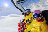 stock photo of family ski vacation  - Ski lift - JPG