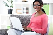 foto of web surfing  - African woman using laptop at home - JPG