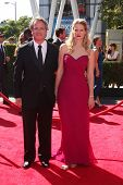 LOS ANGELES - SEP 15:  Graham Yost, Joelle Carter at the Creative Emmys 2013 - Arrivals at Nokia The