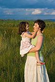 image of fondling  - Lovely girl fondling her mother face - JPG