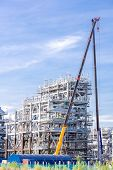 foto of lng  - Assembling of liquefied natural gas Refinery Factory with LNG storage tank using for Oil and gas industry background - JPG