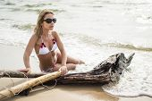 stock photo of undine  - Beautiful girl next to the sea on sandy beach