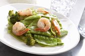 stock photo of snow peas  - Chinese cuisine stir fry snow peas and broccoli with shrimp - JPG